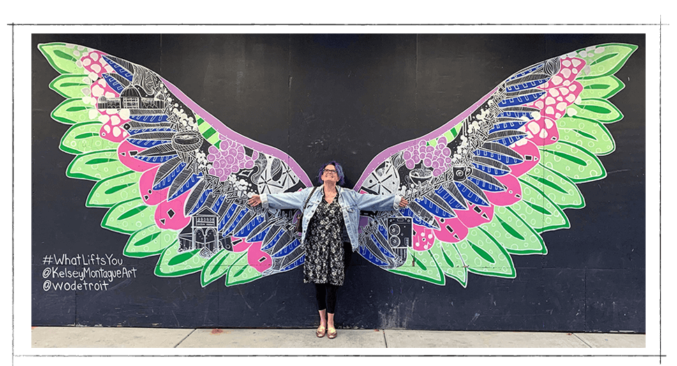 Robin Carberry in front of #WhatLiftsYou wing mural in Detroit