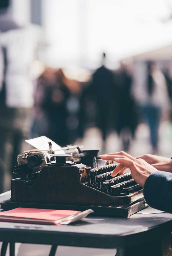 Creating consistent content your clients will love on a typewriter